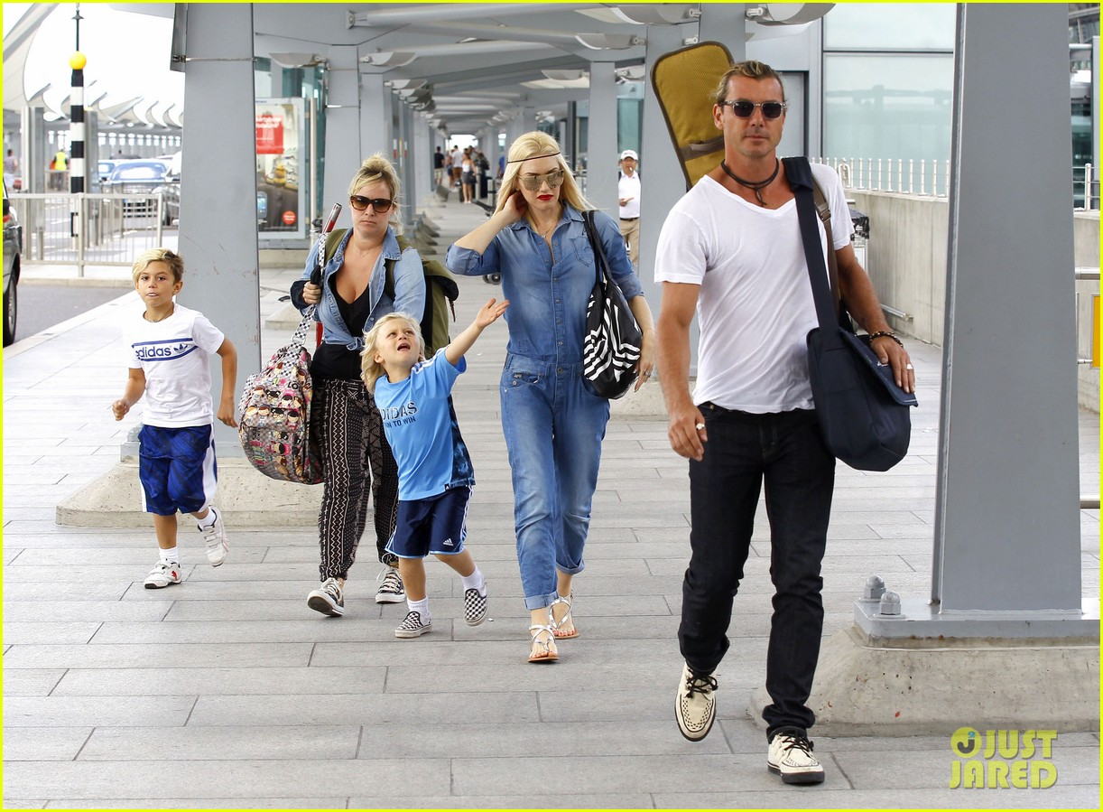 gwen stefani rocks all denim for departing family flight 18