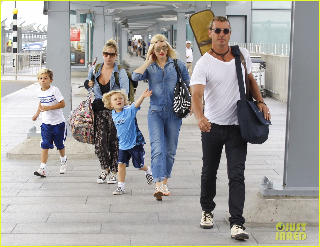 gwen stefani rocks all denim for departing family flight 19