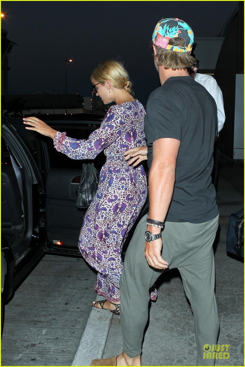 dianna agron nick mathers hold hands at lax airport 062943399