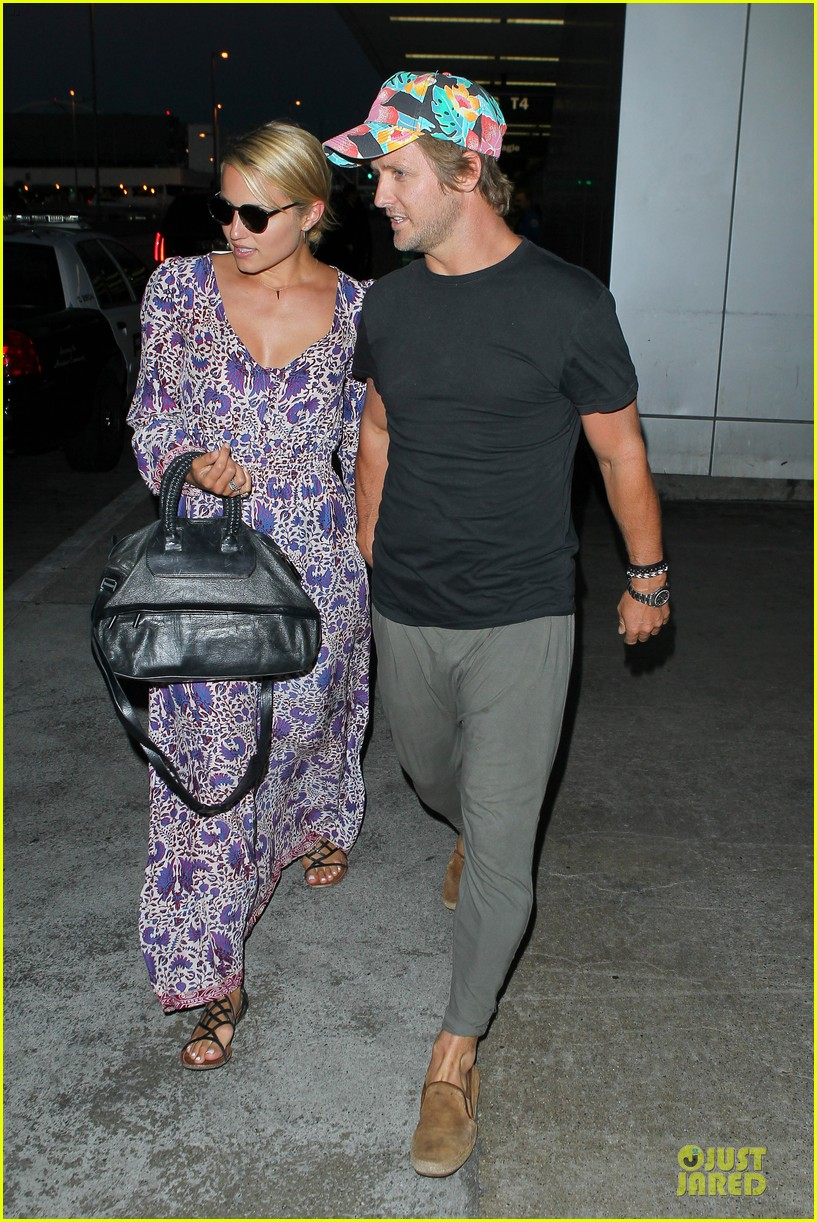 dianna agron nick mathers hold hands at lax airport 082943401