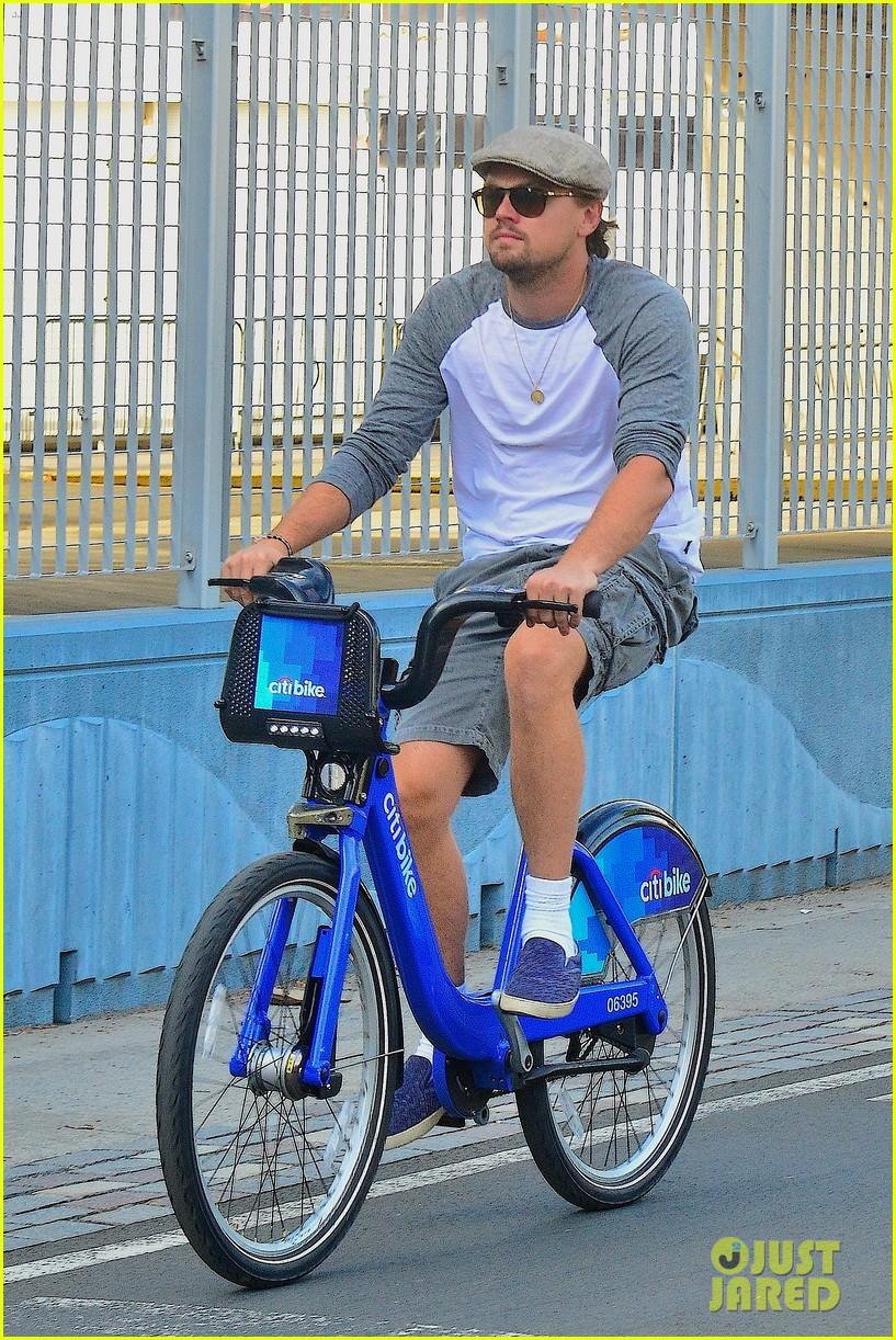 leonardo dicaprio rides a bike toni garrn parties for mademoiselle c 012946440