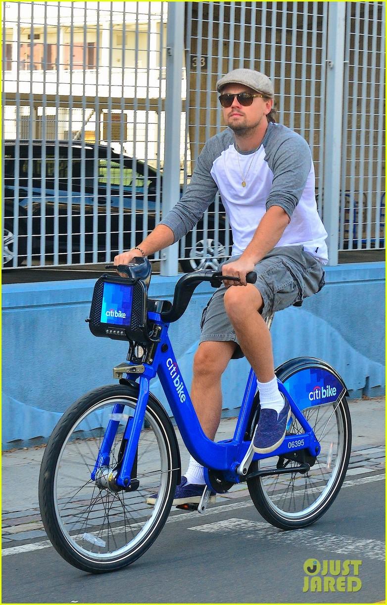 leonardo dicaprio rides a bike toni garrn parties for mademoiselle c 062946445