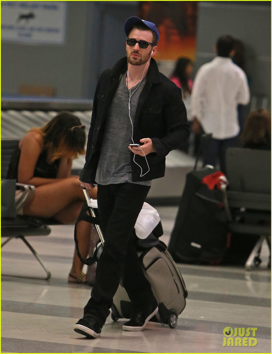 chris evans heads to new york city after disneyland date 01