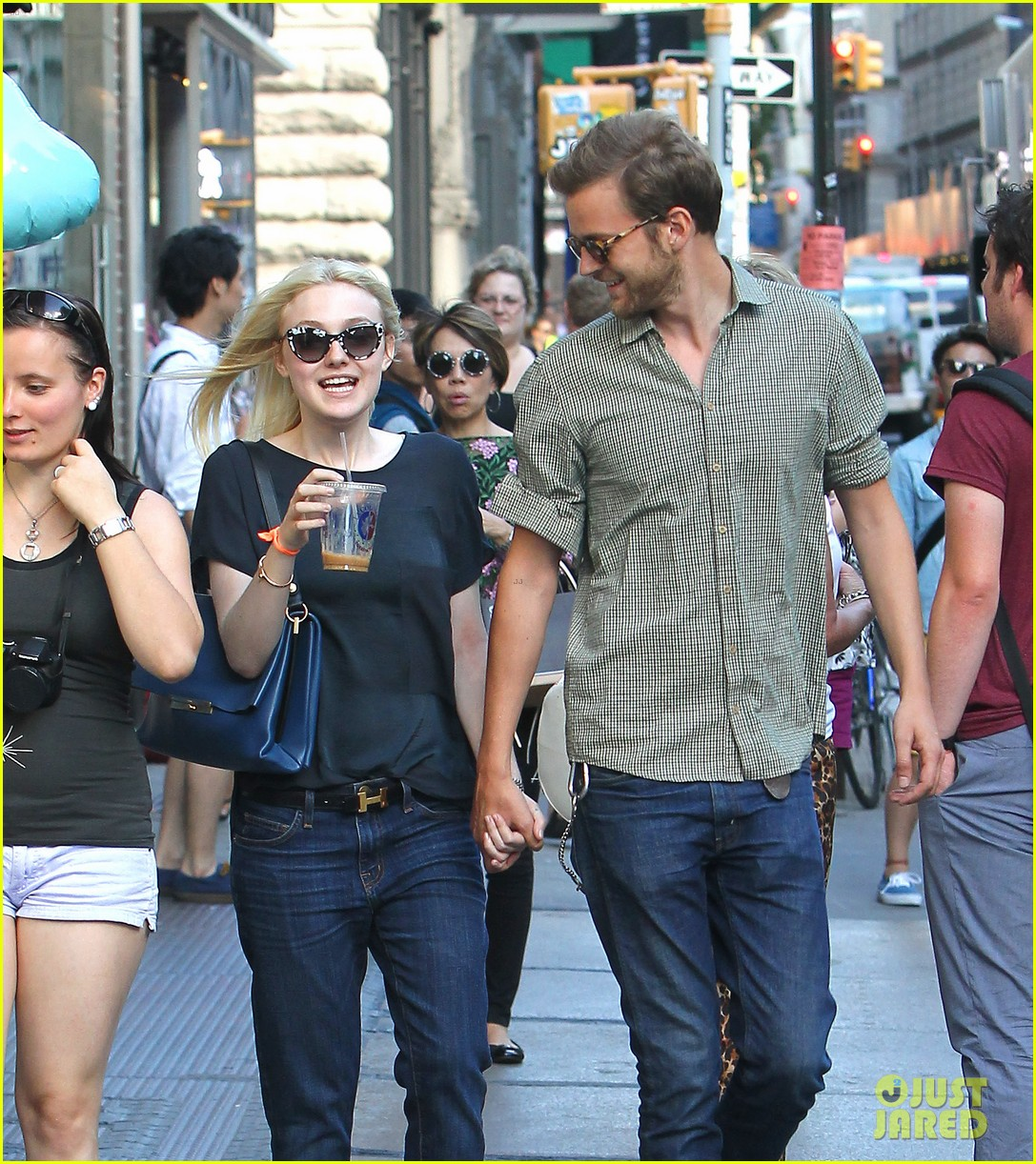 dakota fanning jamie strachan hold hands in new york 142943958