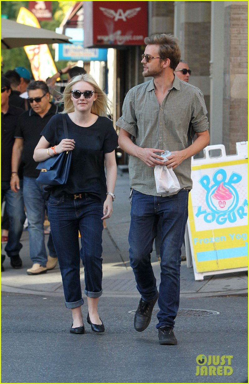dakota fanning jamie strachan hold hands in new york 182943962