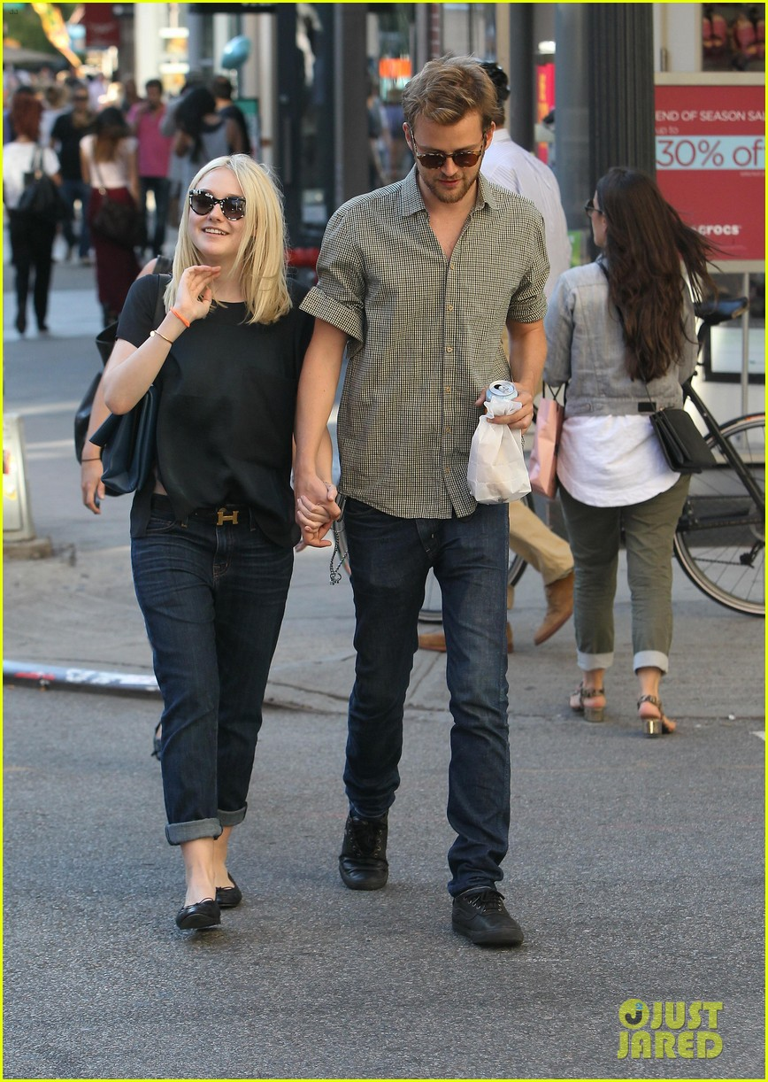 dakota fanning jamie strachan hold hands in new york 212943965
