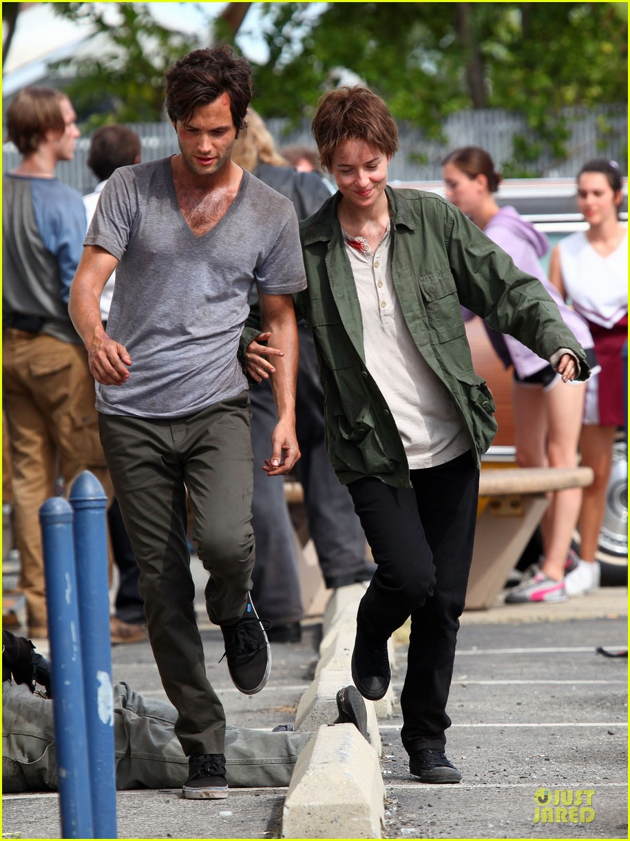 dakota johnson penn badgley hold hands for cymbeline 092948580