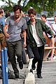 dakota johnson penn badgley hold hands for cymbeline 09