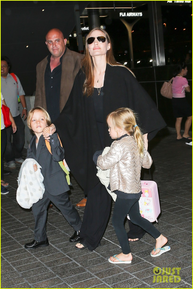 angelina jolie catches a flight with all six kids 05