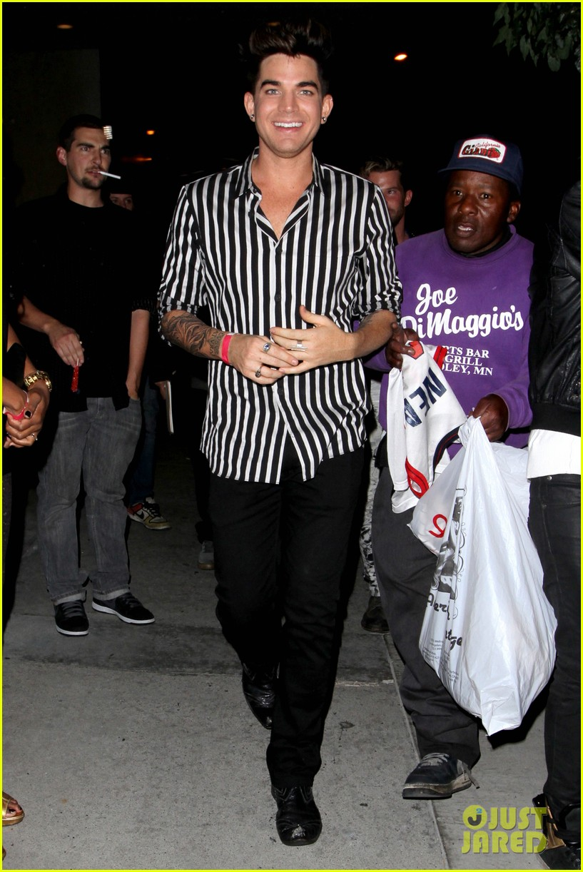 adam lambert smiles wide while heading to bootsy bellows 01