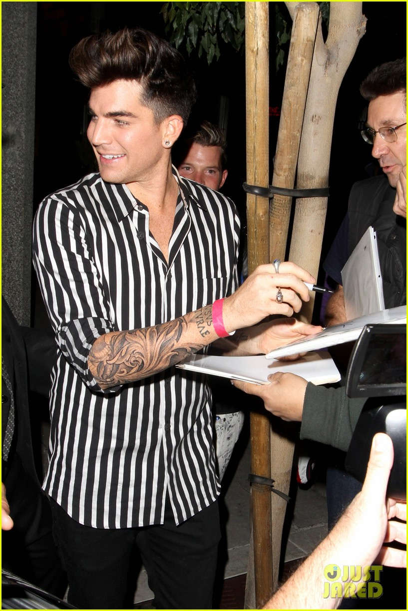 adam lambert smiles wide while heading to bootsy bellows 042961814