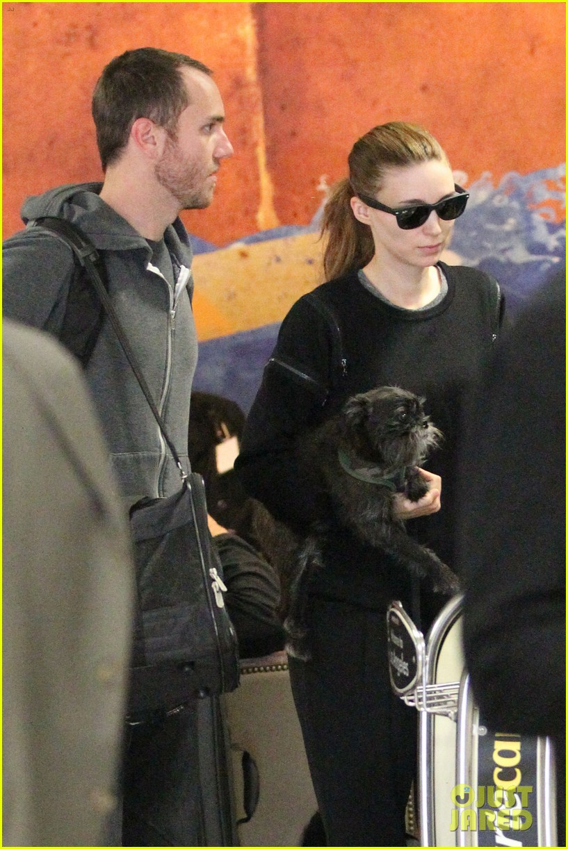 rooney mara holds pet pooch close at the airport 042960777