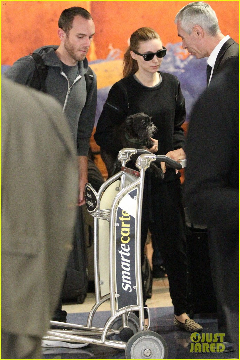 rooney mara holds pet pooch close at the airport 072960780