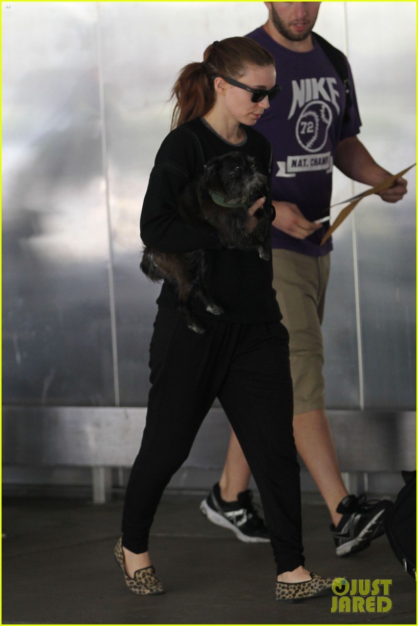 rooney mara holds pet pooch close at the airport 092960782
