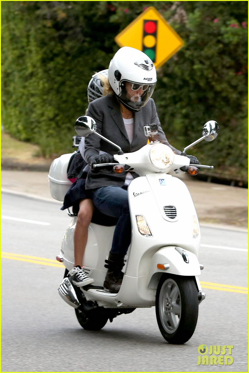gwyneth paltrow chris martin side by side scooter rides 012950235