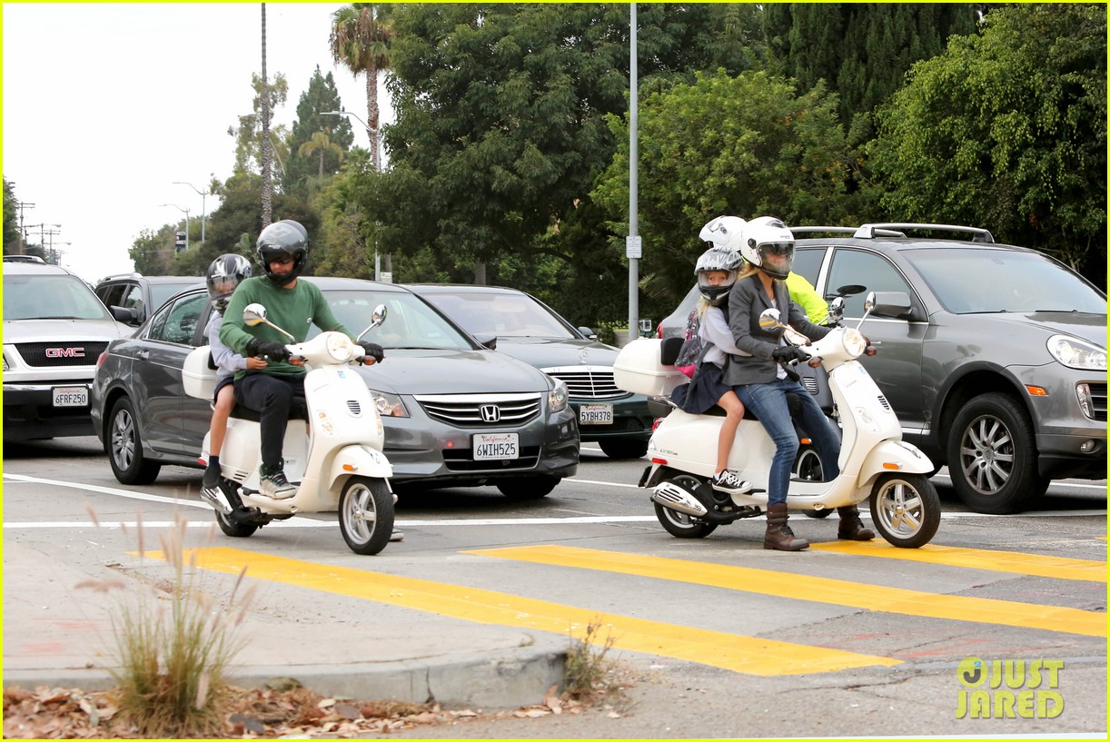 gwyneth paltrow chris martin side by side scooter rides 022950236