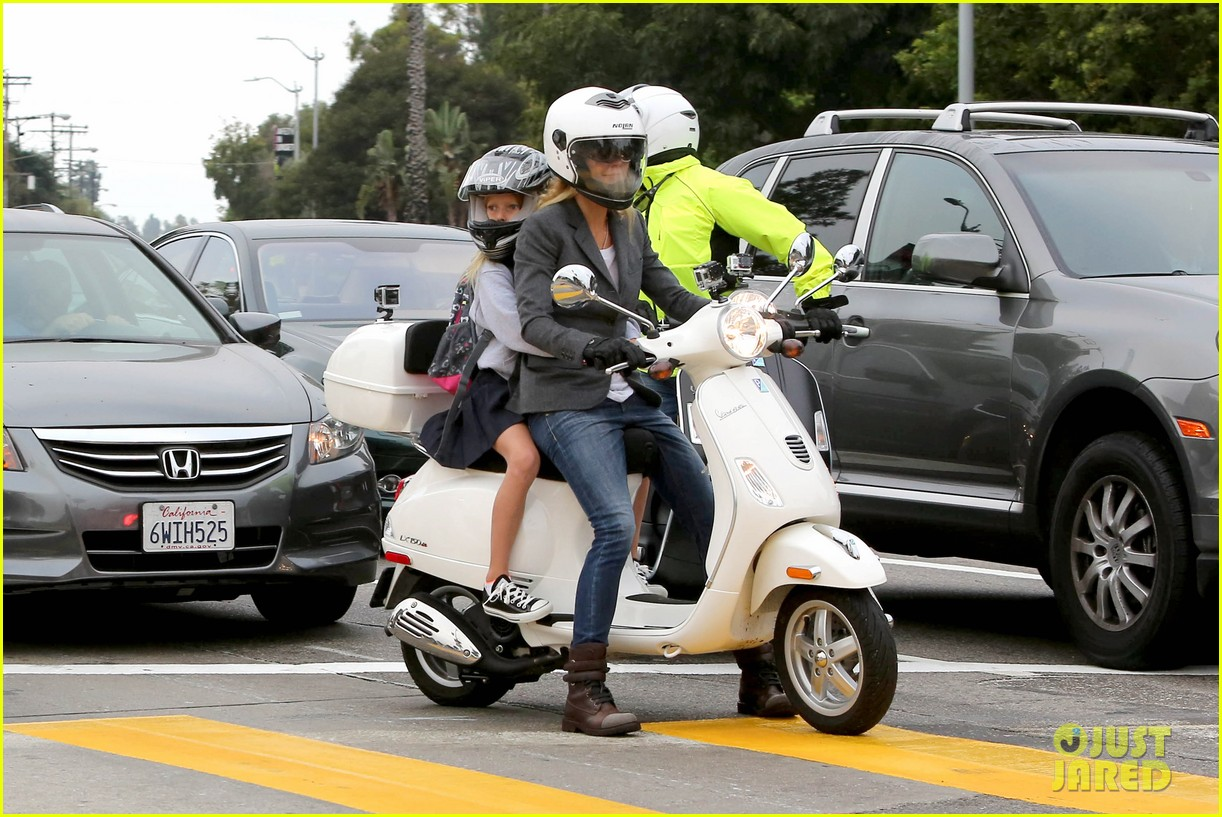 gwyneth paltrow chris martin side by side scooter rides 032950237