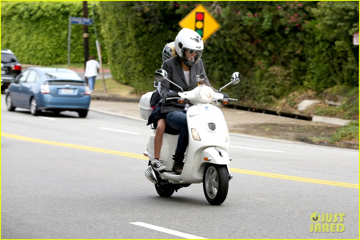 gwyneth paltrow chris martin side by side scooter rides 06
