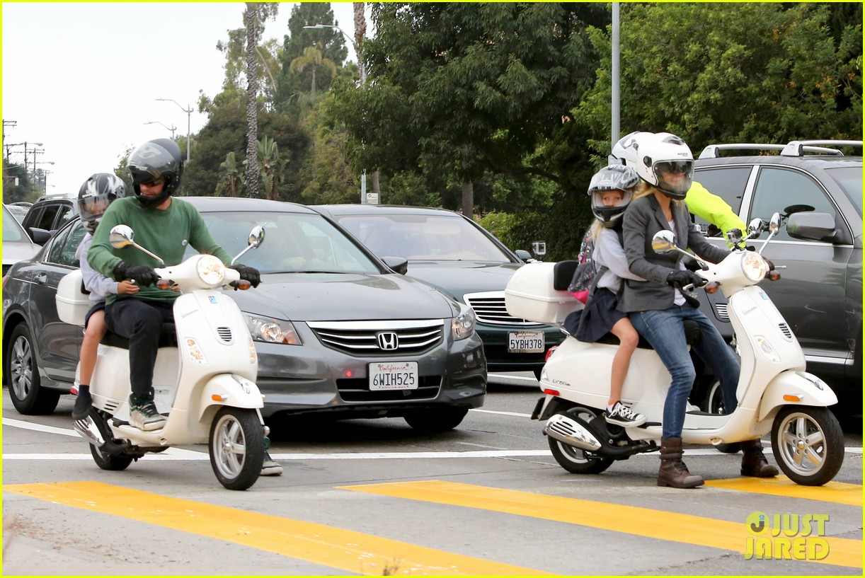 gwyneth paltrow chris martin side by side scooter rides 09
