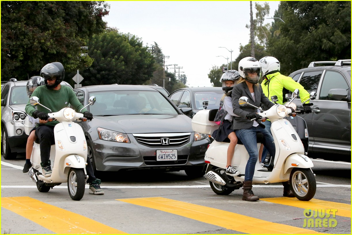 gwyneth paltrow chris martin side by side scooter rides 102950244