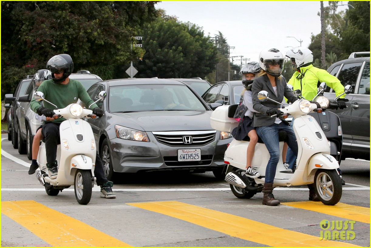 gwyneth paltrow chris martin side by side scooter rides 112950245