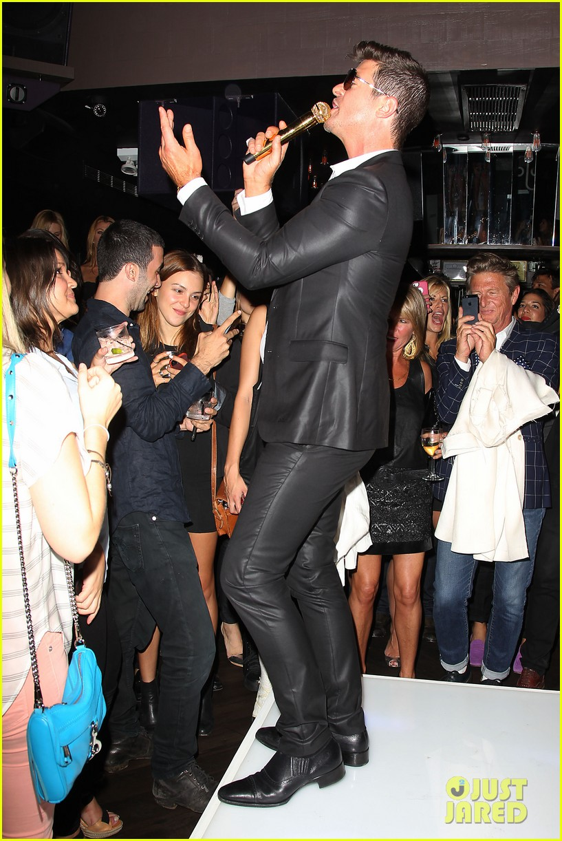 paula patton kisses robin thicke at his album release party 242944341