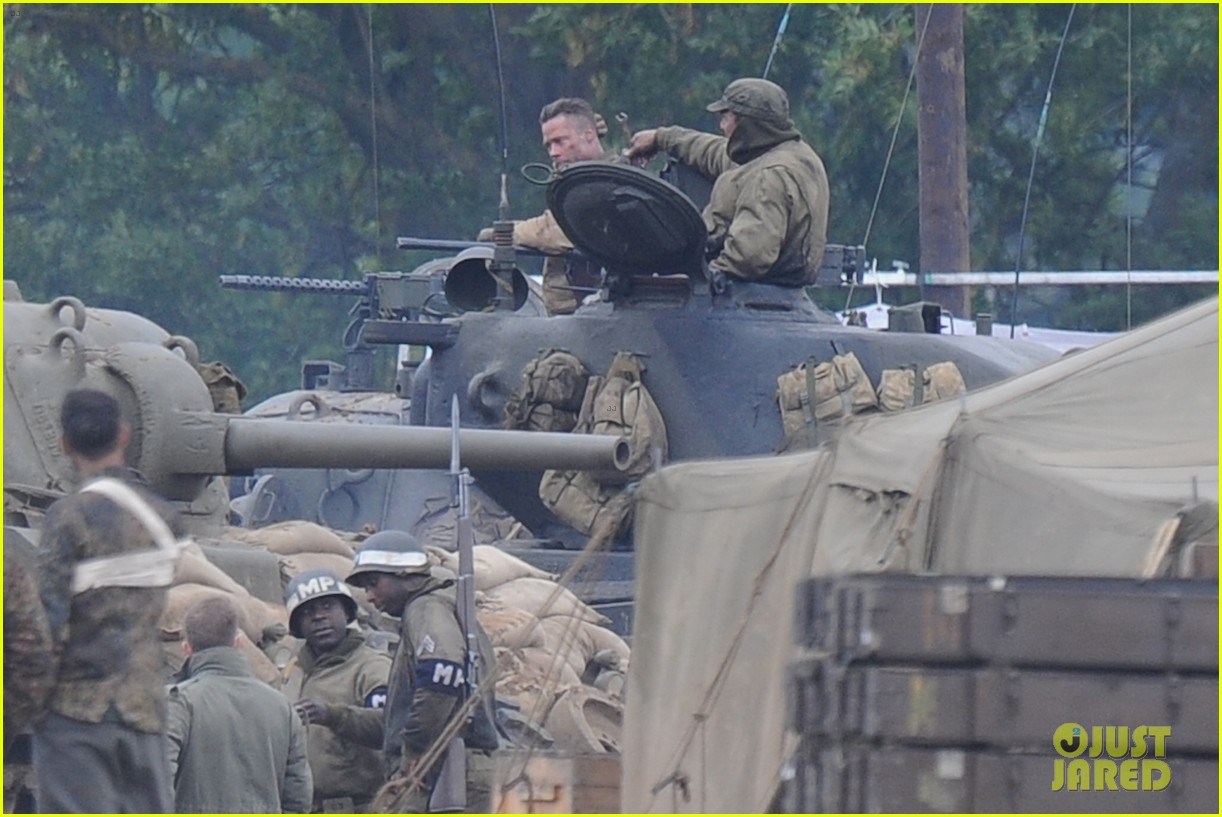 brad pitt rocks slicked back hair army outfit on fury set 09