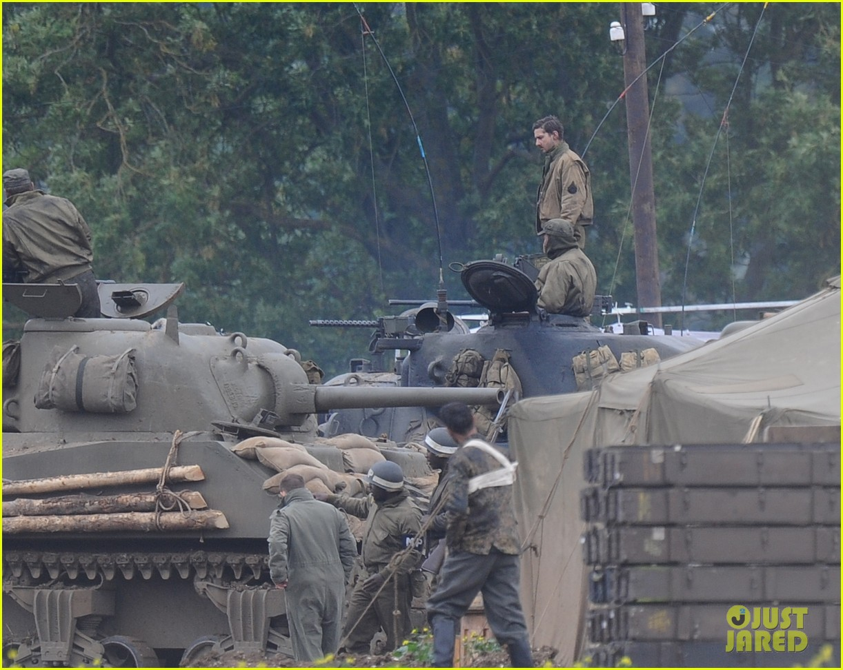 brad pitt rocks slicked back hair army outfit on fury set 13