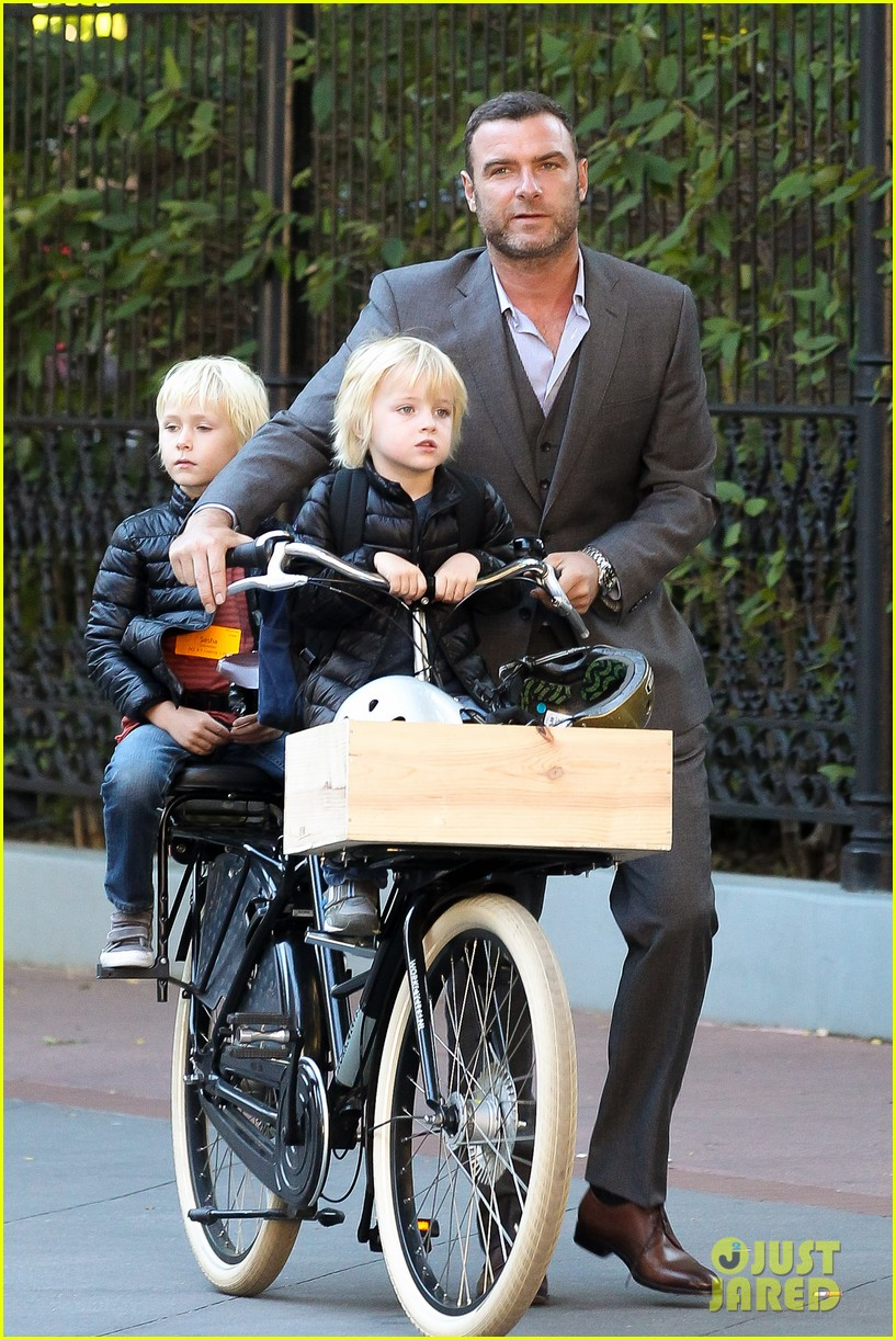 liev schreiber suits up for bike ride with his boys 03