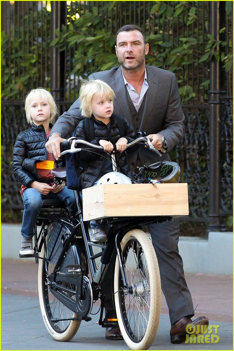 liev schreiber suits up for bike ride with his boys 10