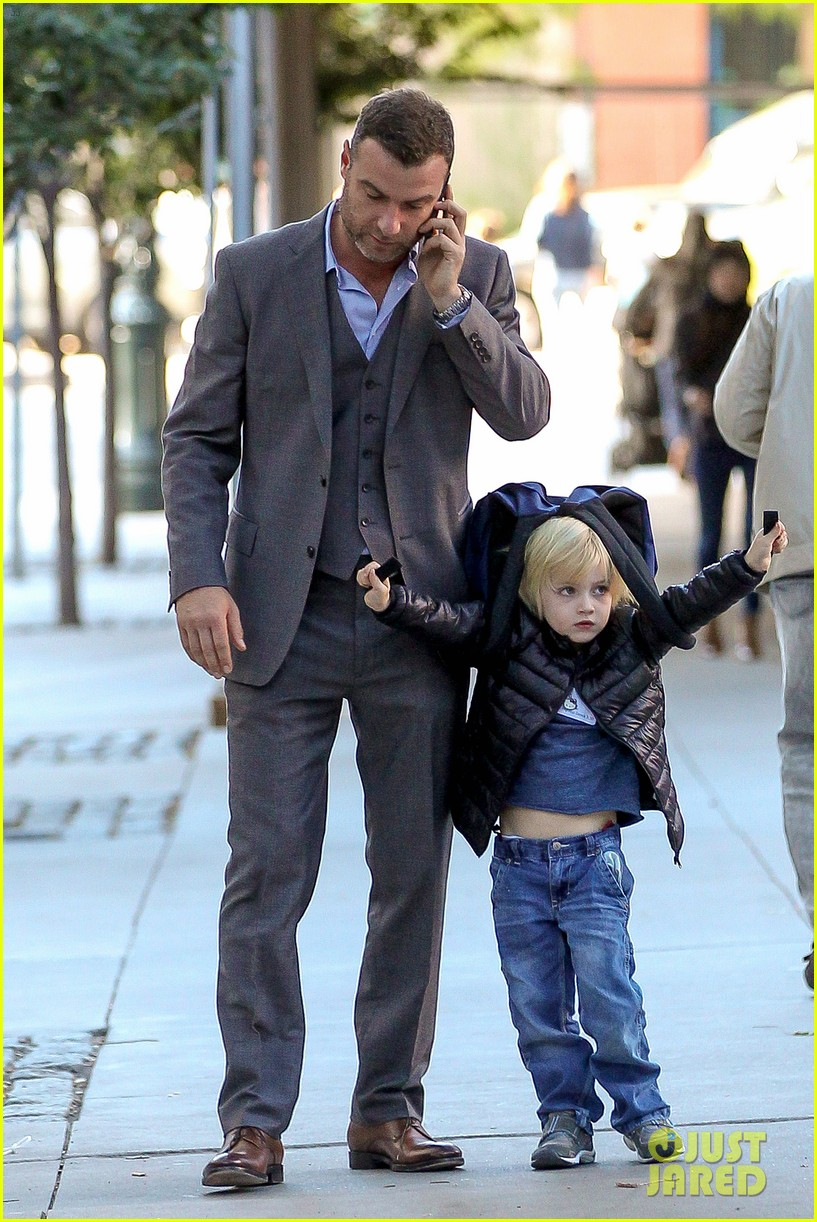 liev schreiber suits up for bike ride with his boys 112959086
