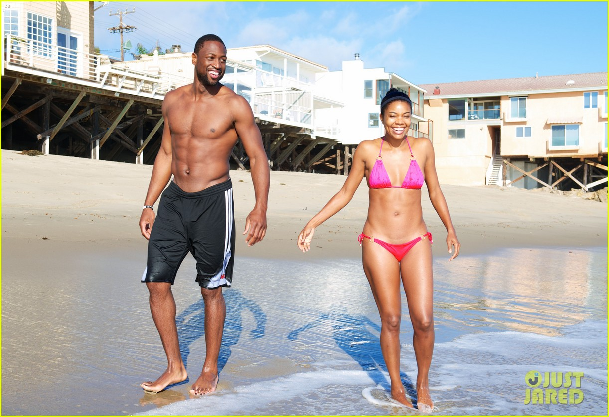 gabrielle union bikini beach babe with shirtless dwyane wade 052957288