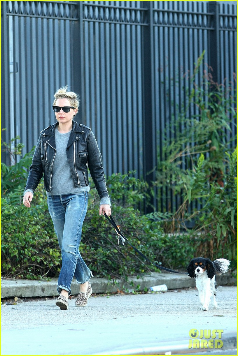 michelle williams goes leather jacket chic for dog walk 012956074
