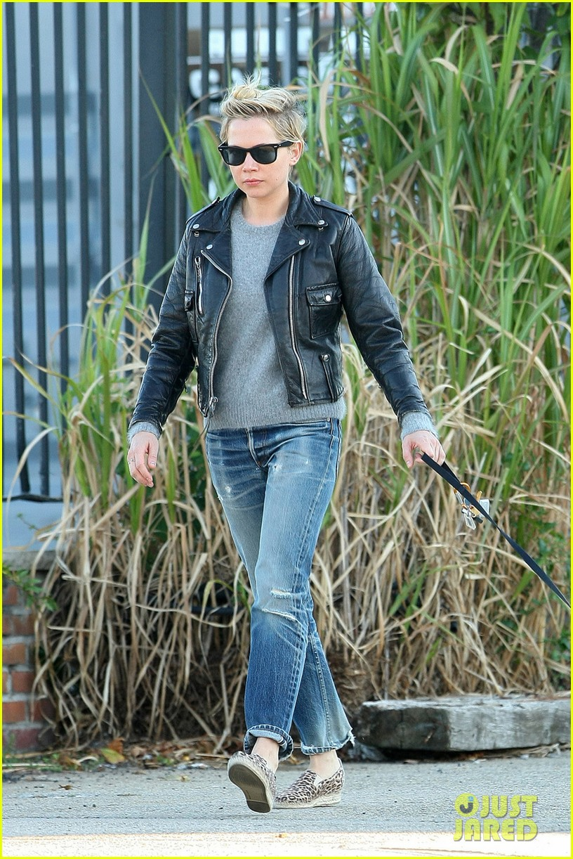 michelle williams goes leather jacket chic for dog walk 022956075