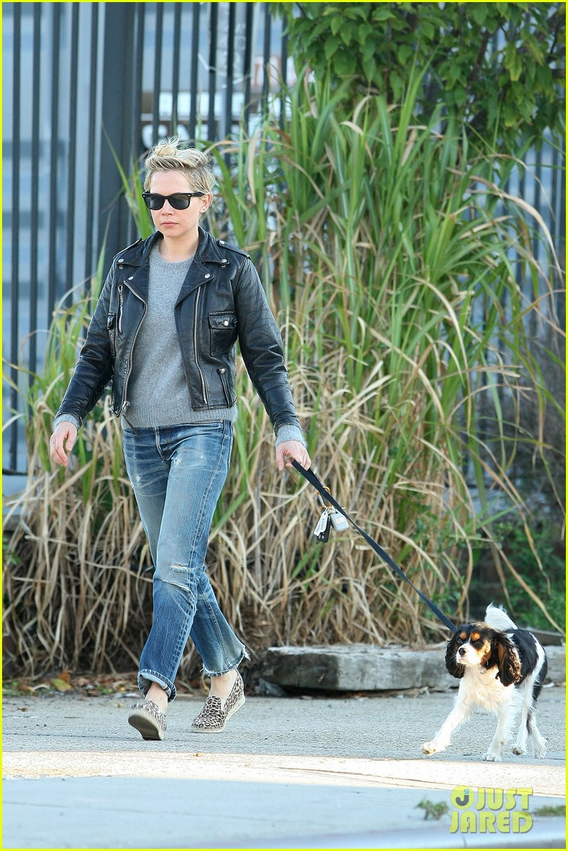 michelle williams goes leather jacket chic for dog walk 042956077