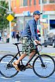 gerard butler camouflages bike ride in nyc 06