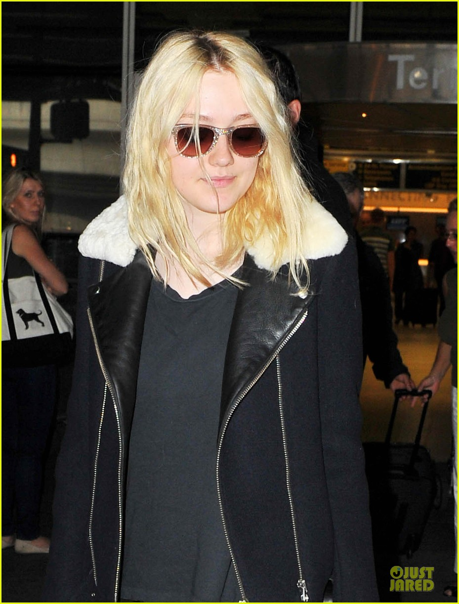 dakota fanning separate landings after paris fashion week 02