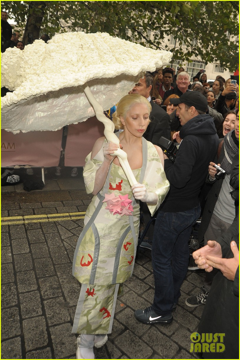 lady gaga carries large seashell umbrella around london 042983430