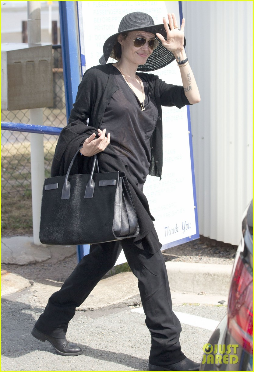 angelina jolie wears mysterious ring on unbroken work trip 052973917