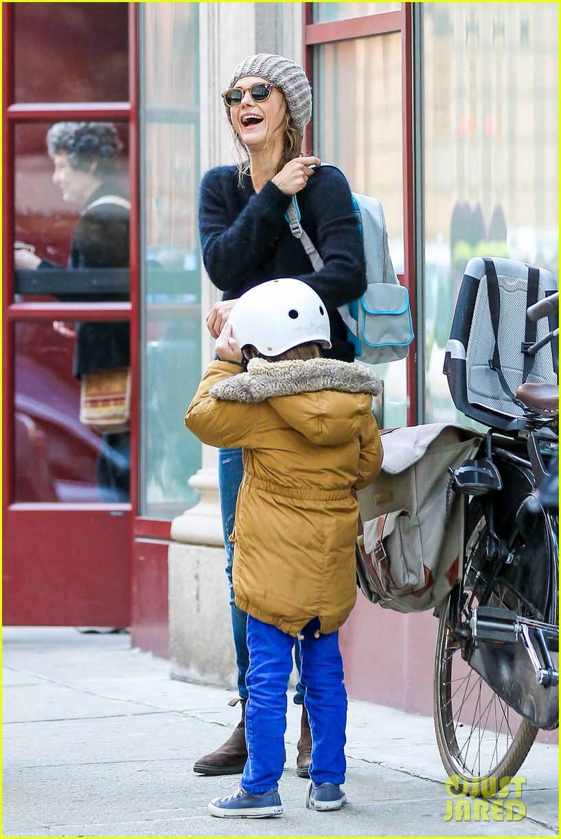 keri russel laughs with river after bike ride 162982395