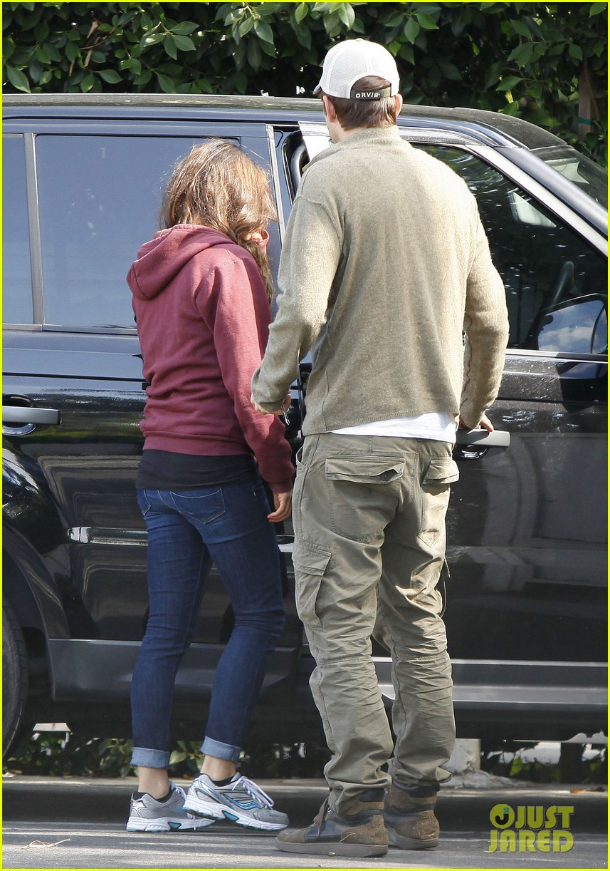 ashton kutchers opens car door for mila kunis 052971376