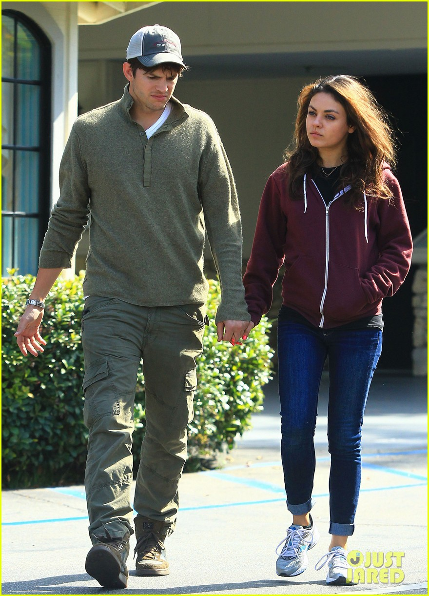 ashton kutchers opens car door for mila kunis 122971383