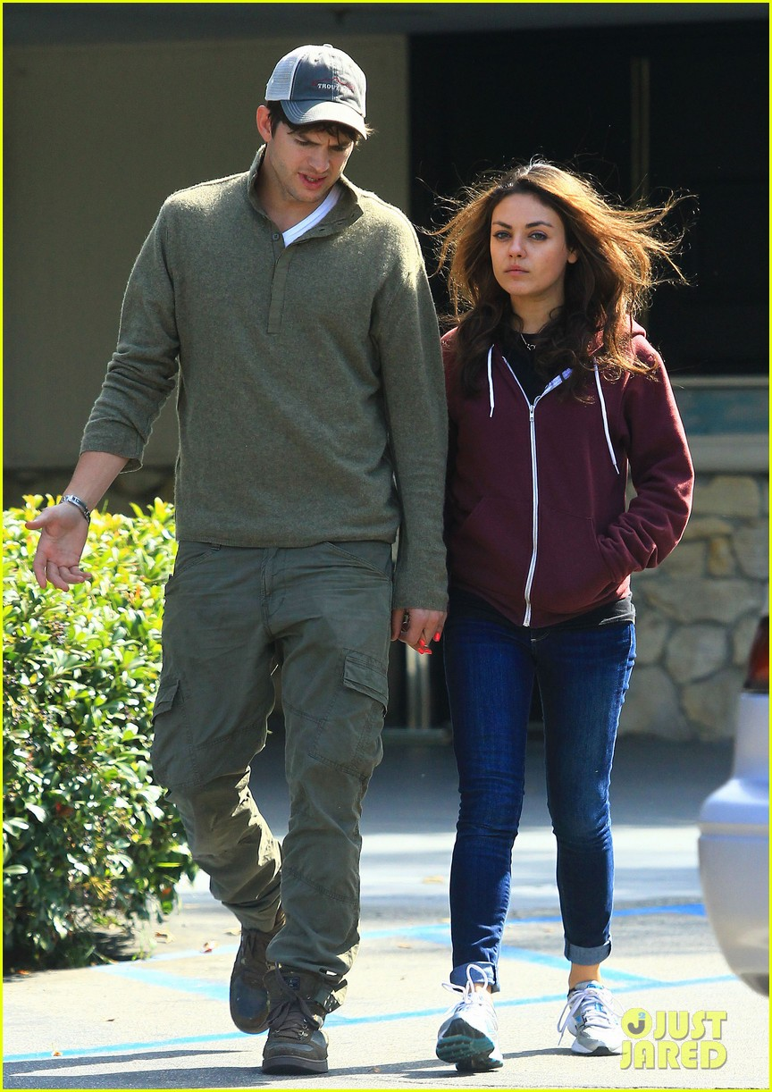 ashton kutchers opens car door for mila kunis 162971387