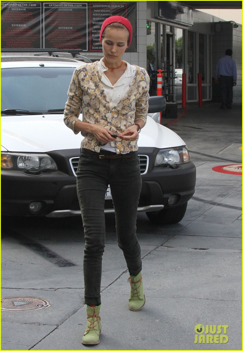 isabel lucas tends to her car at detail shop 102971582