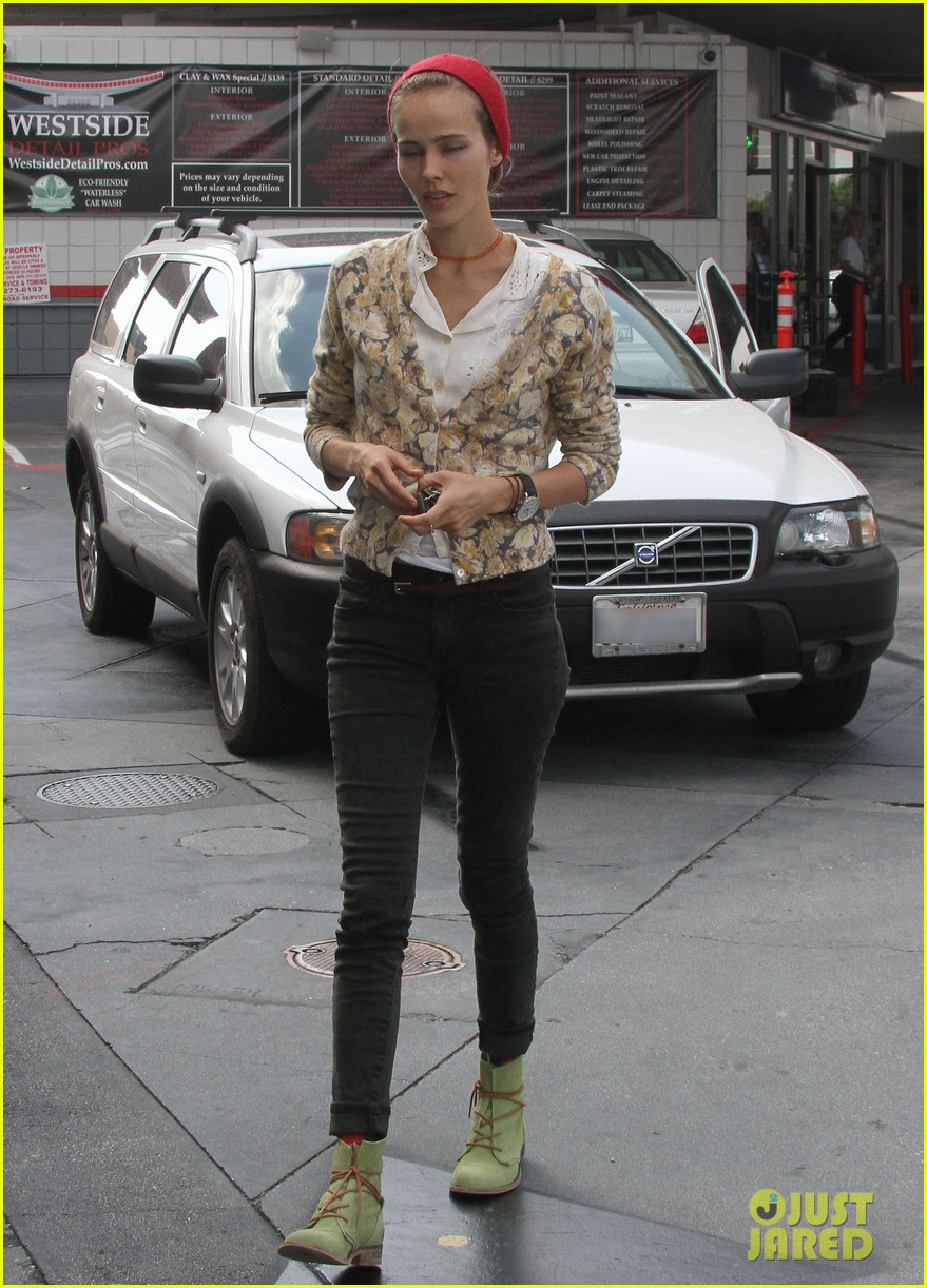 isabel lucas tends to her car at detail shop 112971583