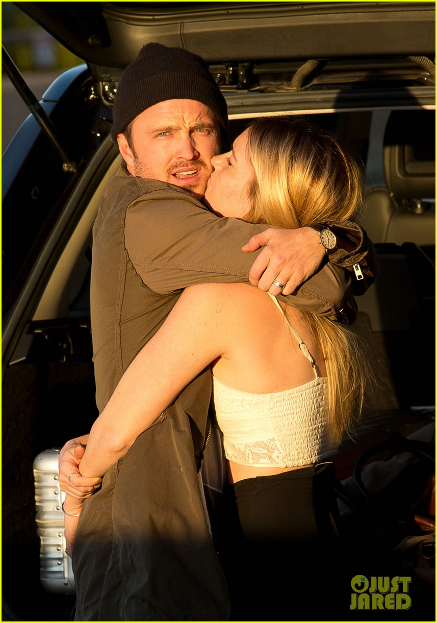 aaron paul gets kisses from lauren parsekian at lax 022967504