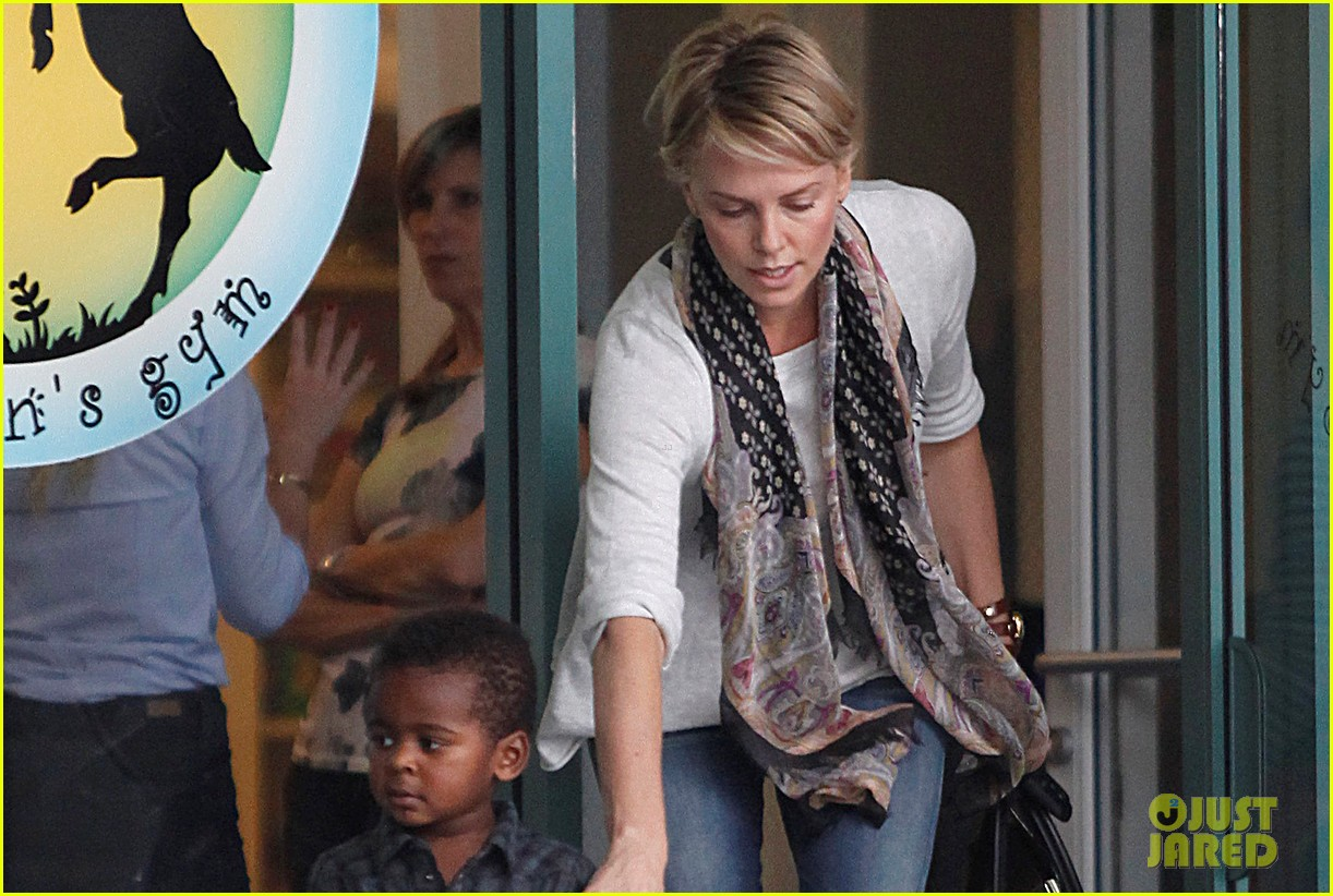 charlize theron holds on tight to son jackson 032969516