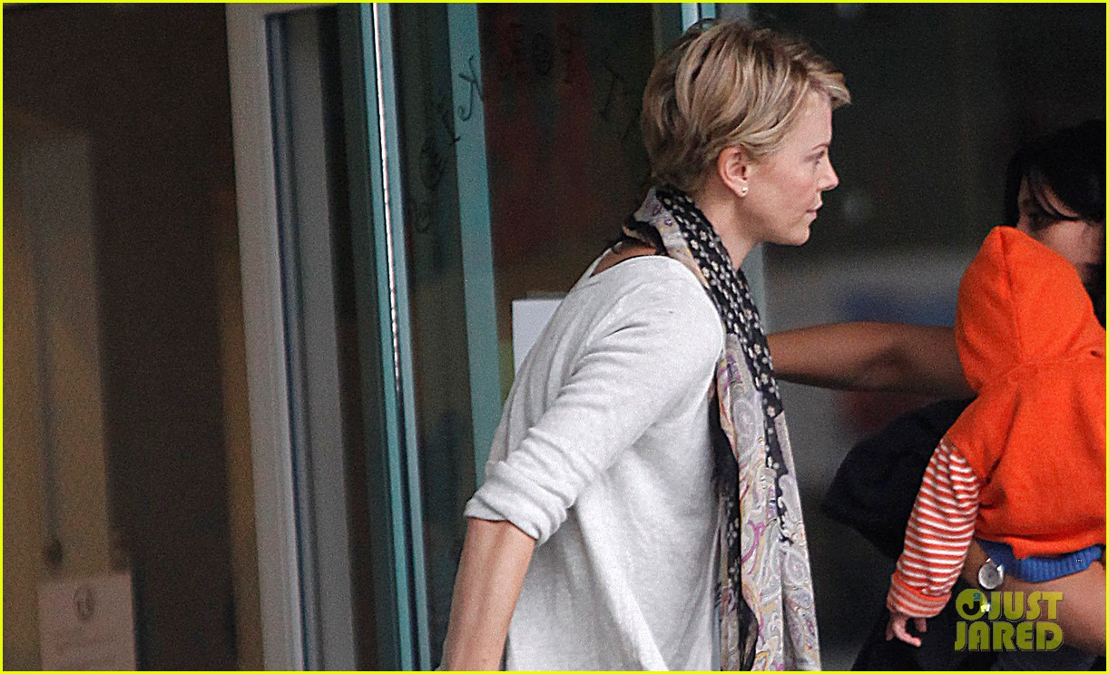 charlize theron holds on tight to son jackson 04