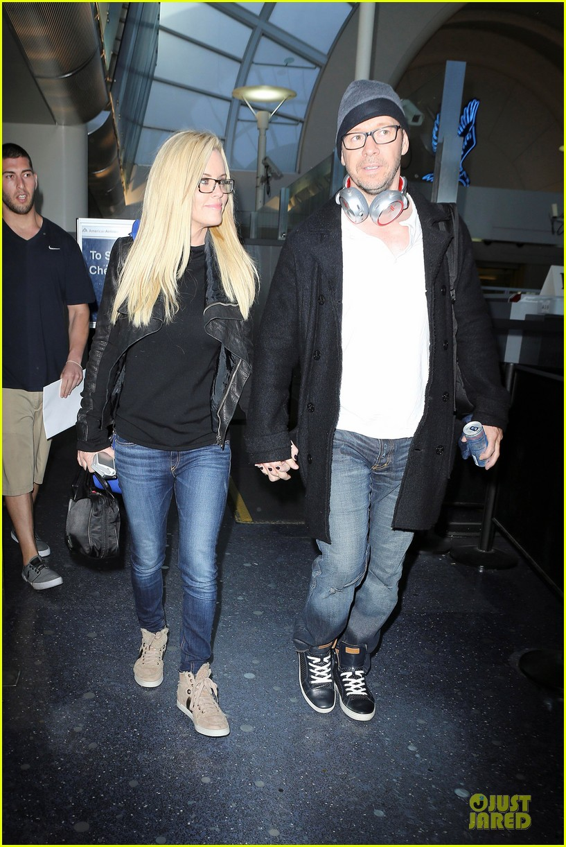 donnie wahlberg jenny mccarthy hold hands at lax airport 022970644