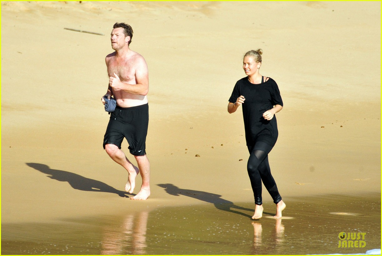 shirtless sam worthington laura bingle beach kissing couple 052969715